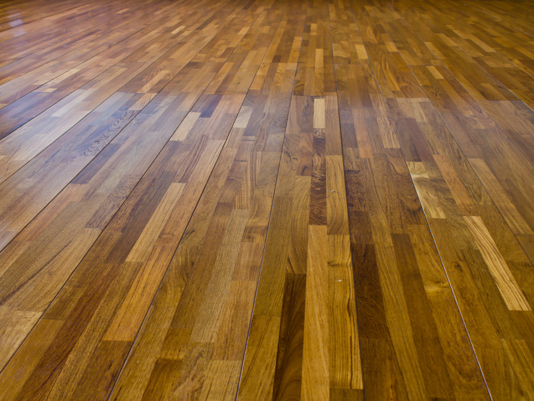 An old hardwood floor that was beautifully refinished by Edy's Flooring, Inc.